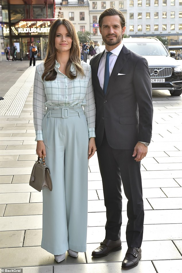 Her husband Carl, 40, cut a handsome figure in a classic suit paired with a white shirt and pocket square, and a navy blue tie