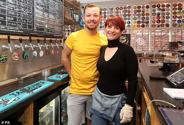 Mr Rickitt with his wife Katy as they begin to prepare their bar for reopening after the government announced that restrictions on bars and pubs would be relaxed from July 4