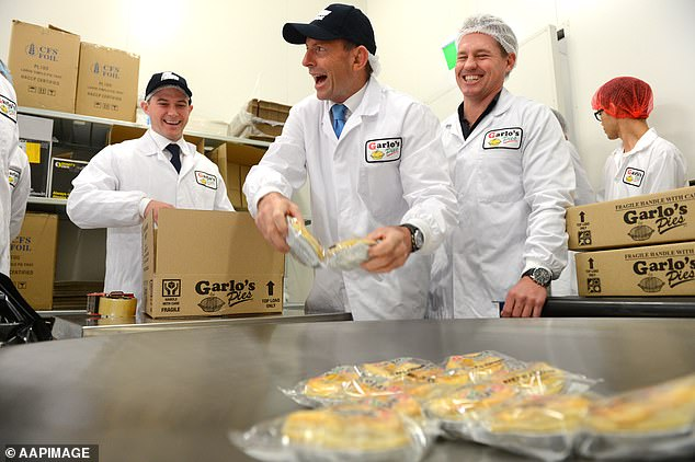 Tony Abbott (centre) packs pies with Sean Garlick (2nd from right), Managing Director at Garlo's Pies in Sydney in 2013