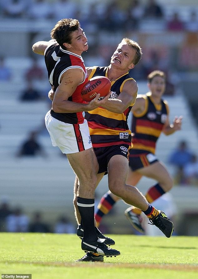Shir played 11 games for the Adelaide Crows in 2001-2002. He is pictured right tackling St Kilda player Lenny Hayes at Football Park in Adelaide on February 24, 2002