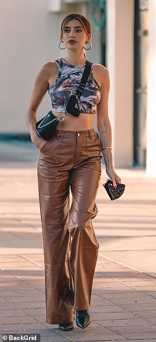 Williams was dressed in a tight-fitting sleeveless crop top and brown leather flares