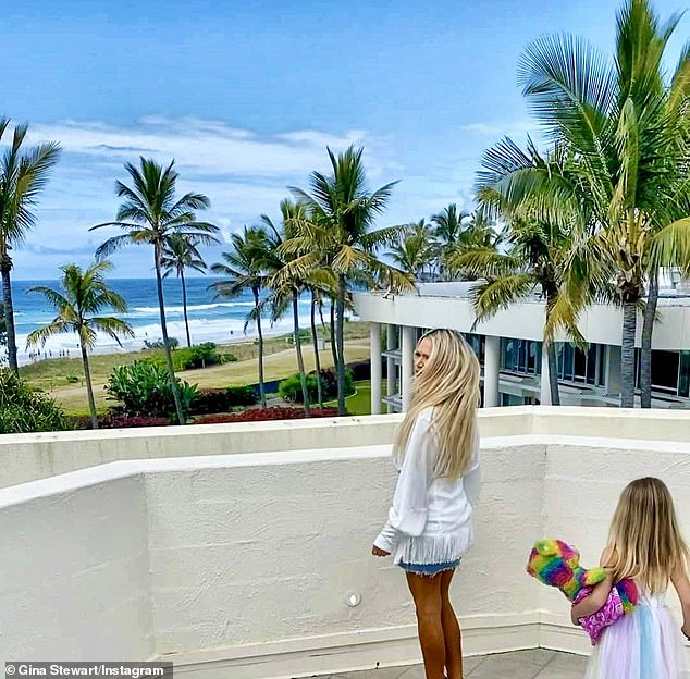 'I stayed in the $1000 per night villa with Casey and Summer with its own private rooftop overlooking the ocean,' she told Daily Mail Australia. (Pictured with Summer)