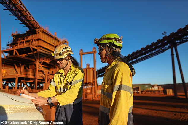In the three months until June, wages grew by just 0.2 per cent. Salaries in mining (pictured are two engineers) grew by 0.5 per cent