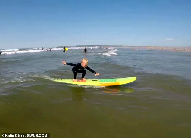 The surfing prodigy has been riding on his father's board since he was two but started surfing on his own a year ago and is a natural in the water
