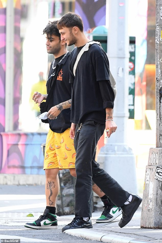 In the Big Apple:Anwar, 21, dressed down in layered black t-shirts and paint-splattered trousers as he strolled around the city