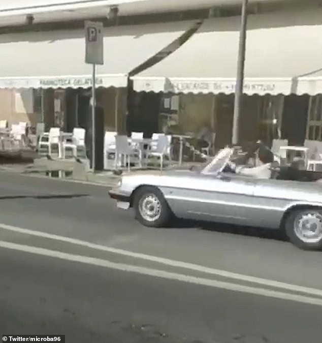 In the driving seat: The star got behind the wheel of a vintage Alfa Romeo to shoot scenes for the video to accompany another song release from his solo album Fine Line