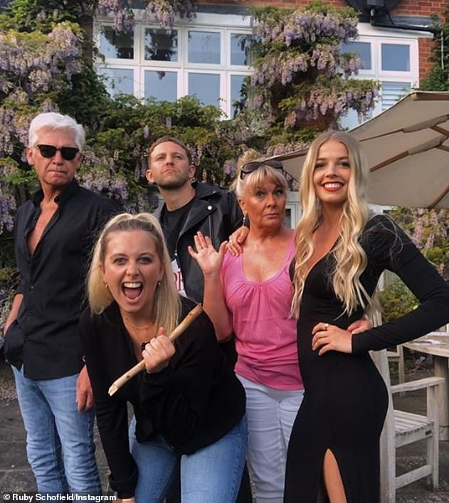 Reports:Meanwhile, it's been reported that the TV personality is planning an 'amicable' divorce from his wife Stephanie, where he will share his £9million fortune (pictured with his family and his daughter's partner during lockdown)