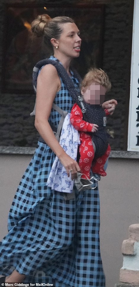 Carrie was seen wearing a blue-checkered dress, black canvas shoes, with her blonde hair tied up in a bun as she strolled with her four-month-old son on Tuesday