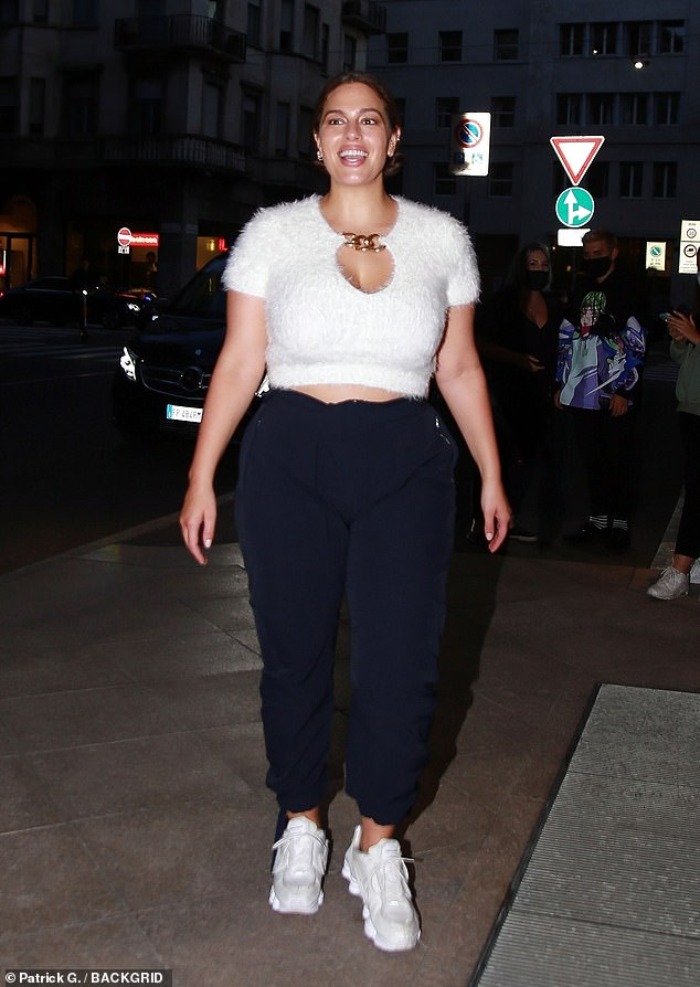 Wow: The sensational model, 32, looked stunning in a white crop top and tracksuit bottoms as she marked the end of her maternity leave in the fashion capital