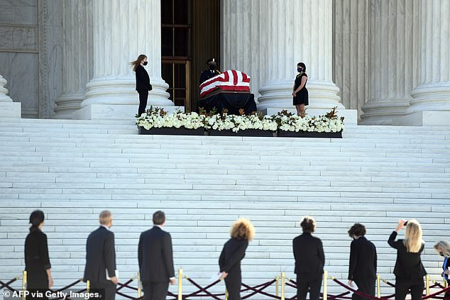 Mourners pass by the Supreme Court stairs where Ruth Bader Ginsburg's casket lies in repose; her coffin will remain on the front steps through Thursday