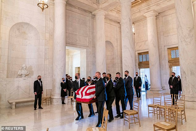 Ginsburg's casket arrives in the Great Hall at the Supreme Court, where a small group of family and friends honored her legacy