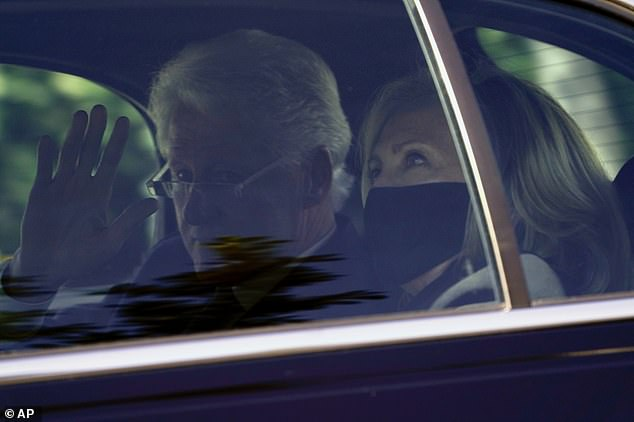 Bill and Hillary Clinton depart the Supreme Court after paying their respects to the late Justice Ruth Bader Ginsburg