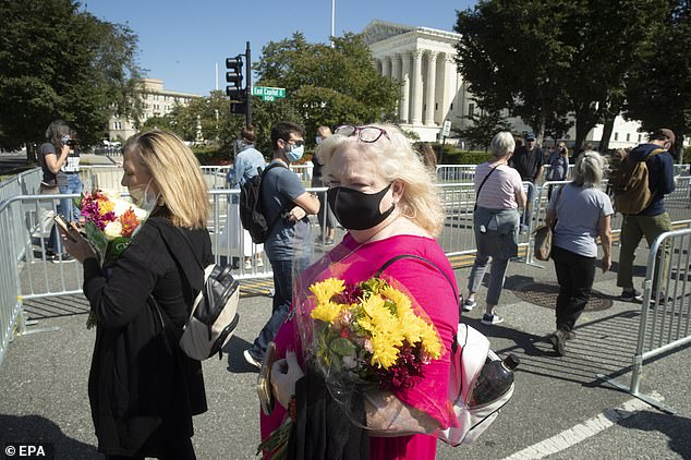 Flowers and other memorabilia have been left in front of the Supreme Court since Ginsburg died on Friday