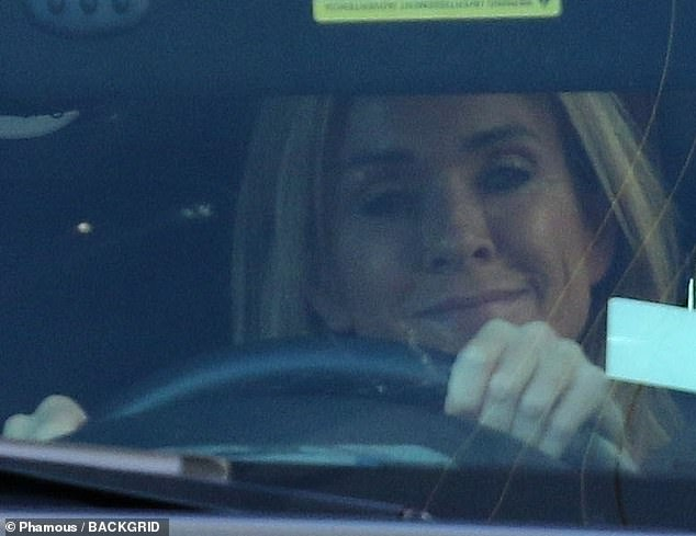 Keeping her chin up: She had a smile on her face as she drove to the studio