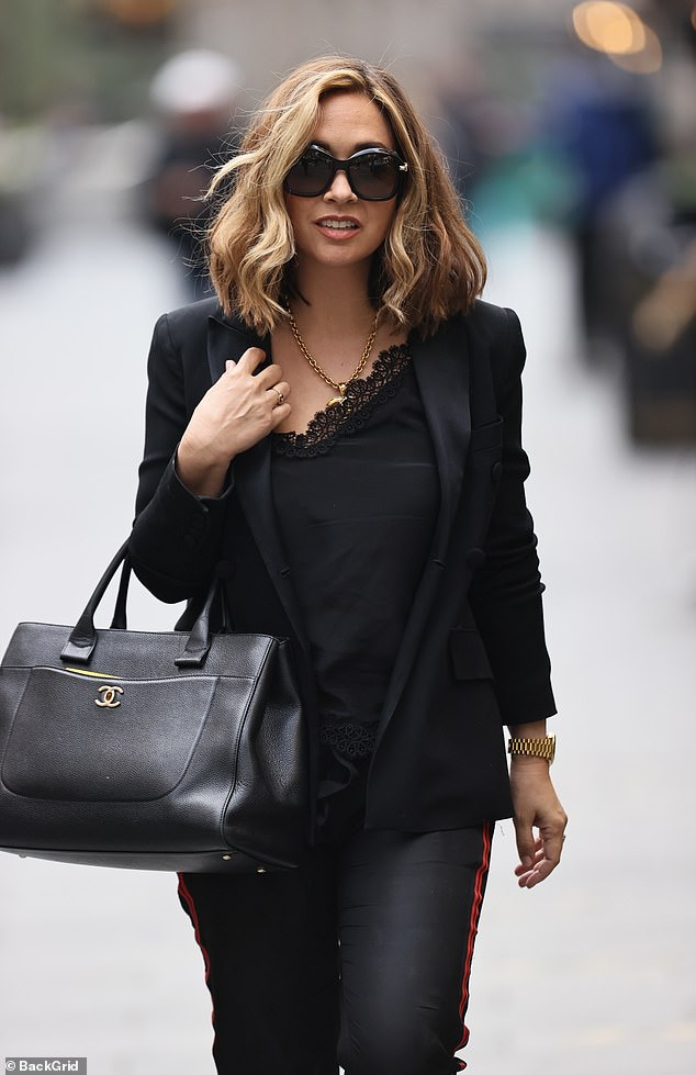 Exciting:Myleene carried her essentials in a matching black handbag as she arrived to record the programme
