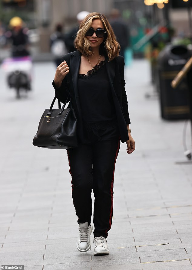 Happy: Myleene Klass, 42, cut a stylish figure as she emerged for the first time since being the first celebrity confirmed for Dancing On Ice 2021, to head to work at Smooth FM on Thursday