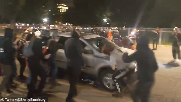 Horrifying footage shows the moment a driver plowed through a group of Black Lives Matter protesters during unrest in Denver, Colorado, following the Kentucky grand jury's decision to not indict any of the police officers with the death of Breonna Taylor
