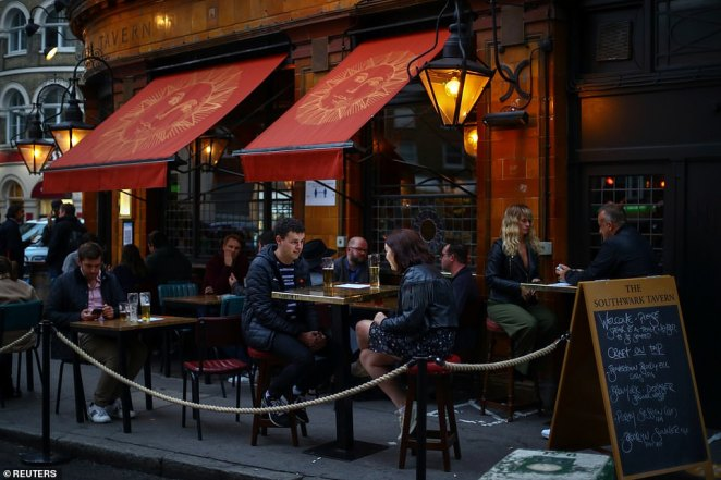 Just hours after the announcement was made by Prime Minister Boris Johnson in a televised address to the nation on Tuesday, food establishments slowly recovering from months of full Covid lockdown were faced with a wave of cancellations from concerned customers. Pictured, people drinking at a pub in London Bridge