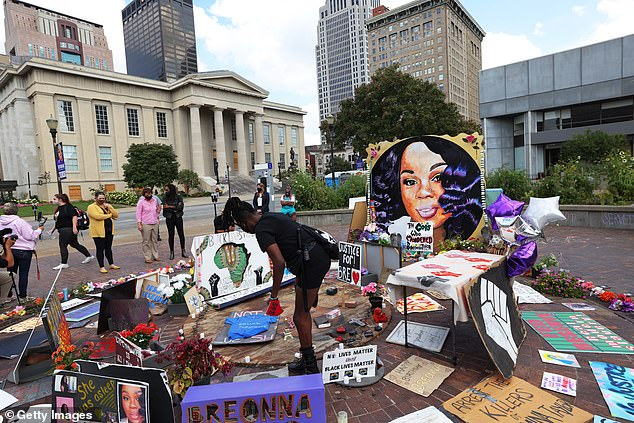 'Self-defence': Cameron, who is the state's first Black attorney general, said that the officers were not charged because they acted in self-defence after Taylor's boyfriend fired at them (pictured is a memorial for the late EMT, in Louisville, KY, earlier this month)