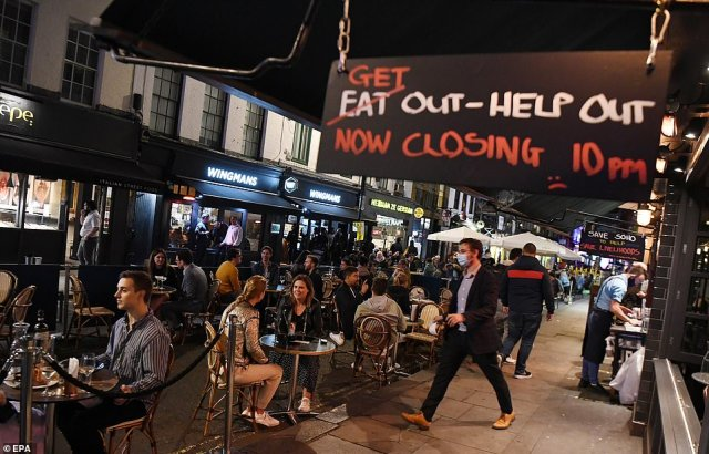 Revellers who headed into town and city centres to enjoy a few drinks tonight were turfed out of pubs and restaurants across England as the country's first 10pm pub and restaurant curfew begins
