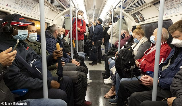 Passengers on the Jubilee Line on London's underground on Thursday morning. The Prime Minister Boris Johnson addressed the nation this week regarding new coronavirus restrictions
