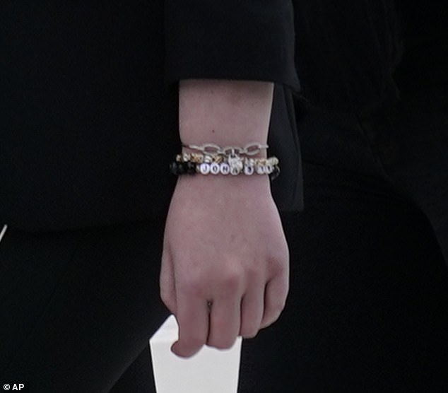 Religious: Tiffany donned a bracelet that had Bible verse 'John 3:16' written in white beads