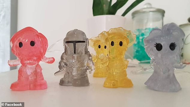 The rarest of the official Ooshie lineup are glitter versions of certain characters. Pictured: Glitter versions of Captain Marvel, The Mandalorian, Woody and Elsa