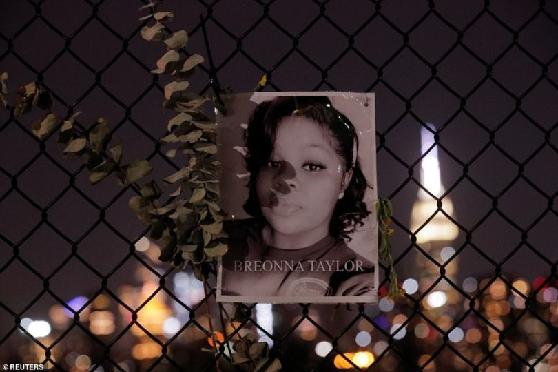 A picture of Breonna Taylor is seen at a makeshift memorial for victims of racial injustice in Brooklyn on Thursday