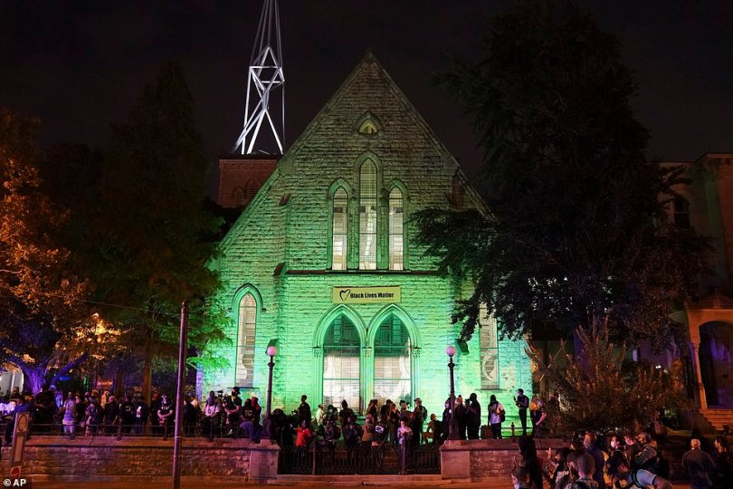 Demonstrators massed at First Unitarian Church in Louisville on Thursday, where clergy allowed them to seek refuge on church grounds to avoid arrest after a 9pm curfew went into effect