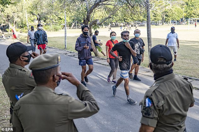 Residents exercising with face masks in Denpasar in Bali this week. Indonesia has recorded more than 197,000 COVID-19 cases and 8,000 deaths