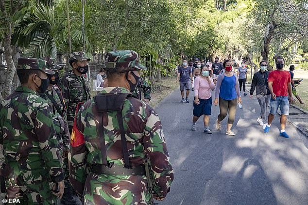 The military are now a common sight on the streets of Bali. Locals are fined 100,000 rupiah if they head outside without a face mask