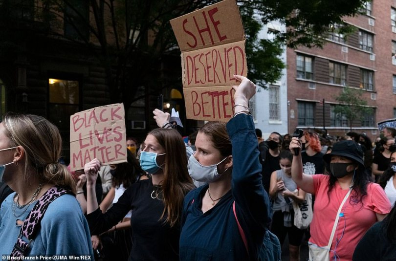 Demonstrators hold signs that read 'She deserved better' and 'Black Lives Matter' on West 15th Street in Manhattan on Thursday