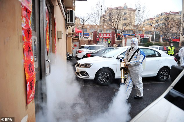 Chinese officials did not say how workers contracted the virus, but said they were `` sharing the common exposure '', referring to imported seafood. A residential area is pictured being disinfected by Red Cross volunteers from the west coast of Qingdao on January 28