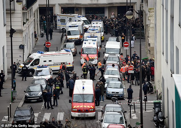 Police and emergency vehicles are pictured at the scene after the gun rampage at the Charlie Hebdo offices in 2015 which left 12 people dead
