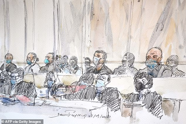 This court sketch shows the fourteen accused and their lawyers at the opening of the trial of the accomplices in jihadist killings in 2015