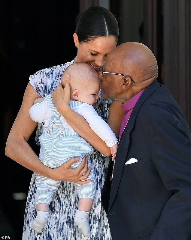 Pictured: Baby Archie being kissed on the forehead by Archbishop Desmond Tutu while in the hands of his mother the Duchess of Sussex in Cape Town, on day three of their tour of Africa