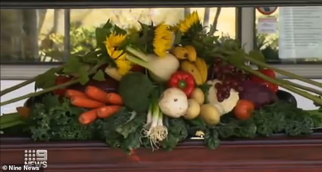 Mr Lombardi's casket was decorated with fresh fruits and vegetables (pictured) because of his love of gardening. He also left mourners with a traditional pasta sauce recipe