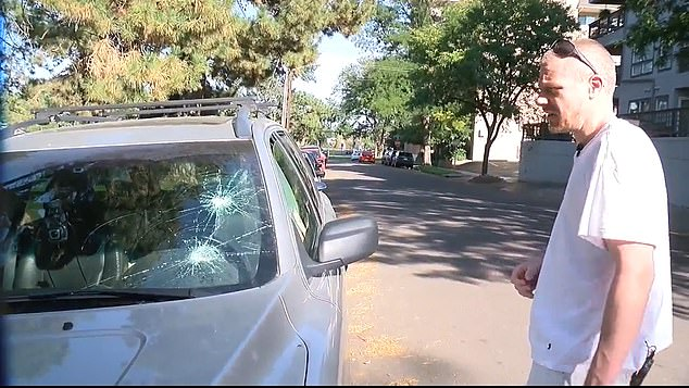 Benson said he reacted in self defense after the group surrounded his car and smashed his windshield (pictured)