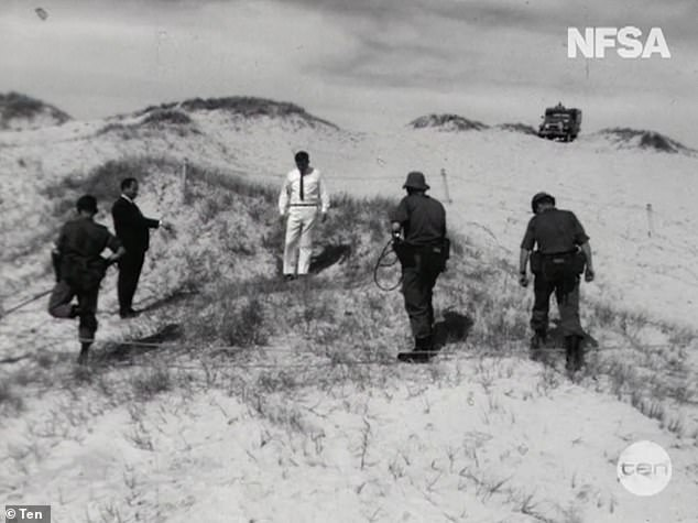 Historic footage shoes detectives searching the sand for their investigation into the Wanda murders