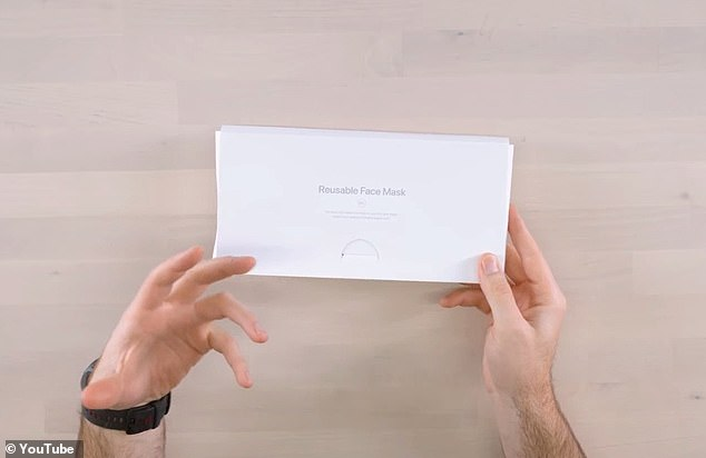 He held up a white box that includes Apple's must-have tagline, 'Designed by Apple in California,' along with 'Assembled in China