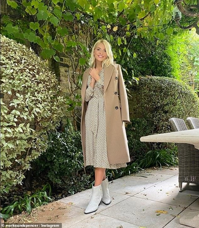 Baker:Holly Willoughby, 39,baked a space-themed rainbow cake with her three children at her £3 million five-bedroom London mansion on Saturday