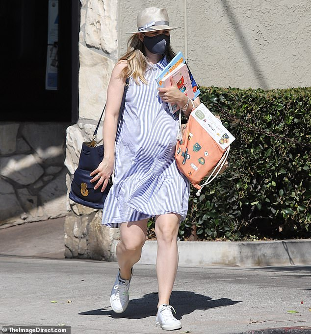 Bump it up: Rachel McAdams, 41, was spotted out in Los Angeles Friday putting her growing bump on display. The actress appeared to make a few pit stops, picking up some supplies for her two-year-old son before grabbing coffee and breakfast
