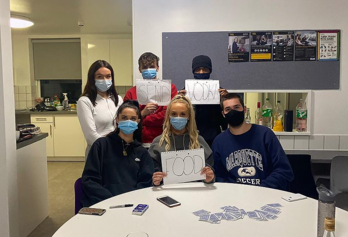 Students on Friday night at Manchester Metropolitan University's Birley campus who have been placed in lockdown for 14 days after positive Covid-19 tests on site