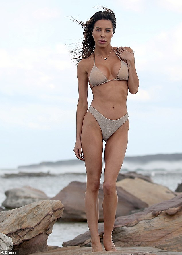 Work it: Married At First Sight's KC Osborne showed her ex-boyfriend Michael Goonan what he was missing by stripping down for an incredible bikini shoot on the beach