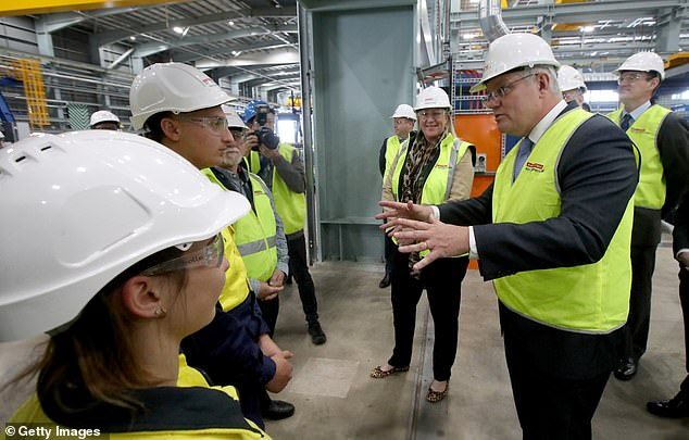 The Australian leader is pictured speaking with apprentice welders during at the Osborne Naval Shipyard on September 26 in Adelaide