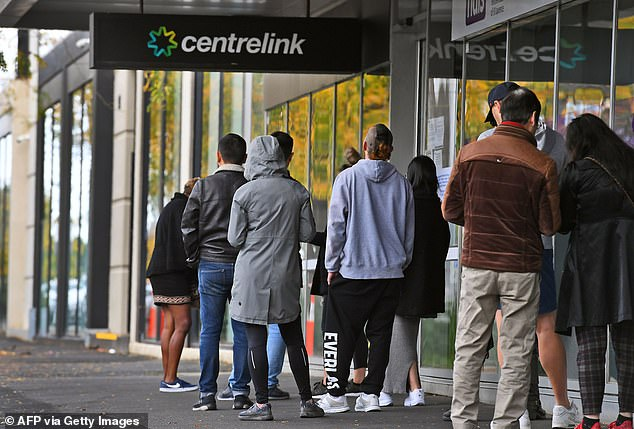 Those out of work were hit with a cut to their dole on Friday as the JobSeeker supplement was reduced from $550 a fortnight to $250 (pictured: Job seekers queue up outside a Centrelink office in Melbourne on April 20)