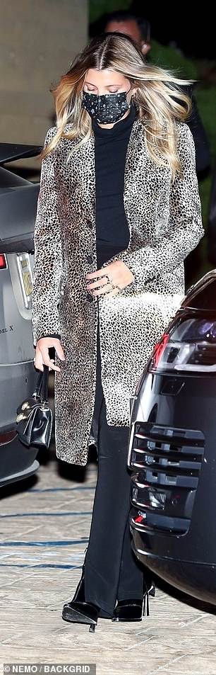 All eyes on her: The blonde beauty turned heads in a cheetah print coat and flared jeans as she left Nobu separately from Jaden