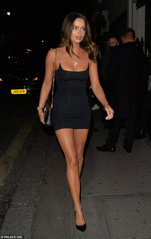 Legs eleven: The stunner, 29, looked jaw-dropping in a Nineties-inspired black mini dress with spaghetti straps while she showcased her phenomenal pins