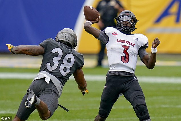 Quarterback Malik Cunningham was hit while throwing the ball during Louisville's game against Pittsburgh