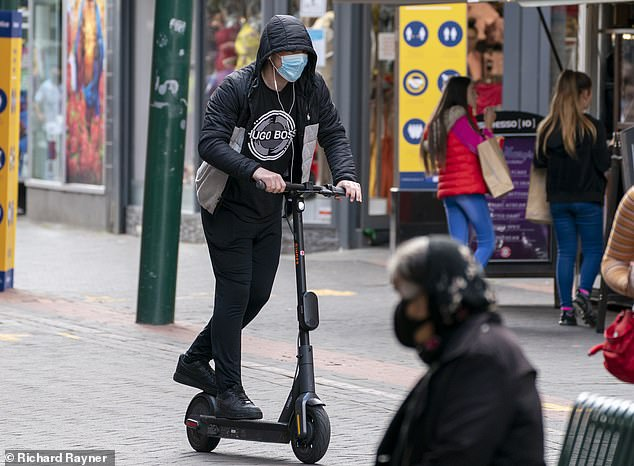 Electric scooter owners are offering online guides showing users how to override the devices¿ speed-limiting software to reach up to 40mph. An e-scooter user is seen riding through thepedestrianised town centre of Middlesbrough